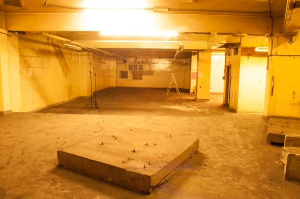 """The basement from the """"top"""" end by the spiral staircase."""